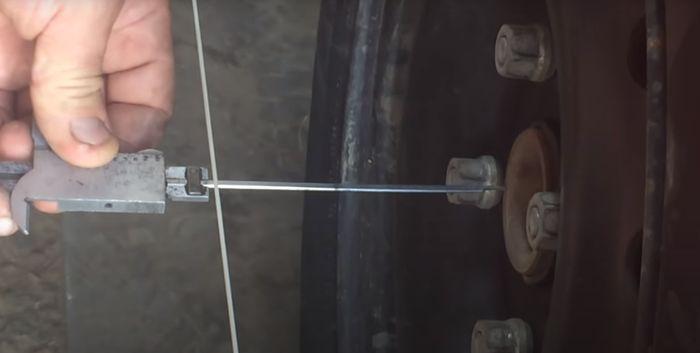 Измерение расстояния от центров ступиц до нитей базового коридора.